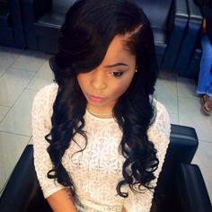side part sew in. sassy mitchell hair.