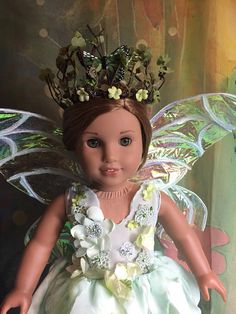 Beautiful and very detailed custom OOAK woodland fairy outfit made for 18 inch dolls! The gown has multiple layers of 'petals' flowing down, handsewn and handmade flowers and embellishments and a corset tie back. This outfit is made in a whimsical 'artsy' style and has unfinished
