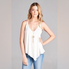 Asymmetric Tank (White) Jersey loose fit tank with asymmetric hem. So comfortable and light! Material is 100% rayon jersey. Vega Boutique Tops Tank Tops