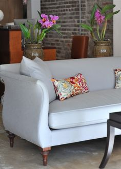 A great sofa from Dwelling in Charleston, SC - and I love the orchids @Leigh McAlpin