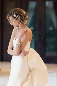 Lyon Hair Combs featured with Maria Elena matching cuff bracelet and Ulla Maija Anna Maier satin wedding dress Felicite. Click on photo to view our online accessories boutique! Photo by Kristen Weaver Photography. Hair and Makeup by Makeover Station. Editorial at Waldorf Astoria Orlando