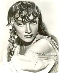 """Marlene Dietrich in """"Golden Earrings"""" wearing Joseff Hollywood Jewelry...Coin necklace worn in her hair gives her that gypsy look!"""