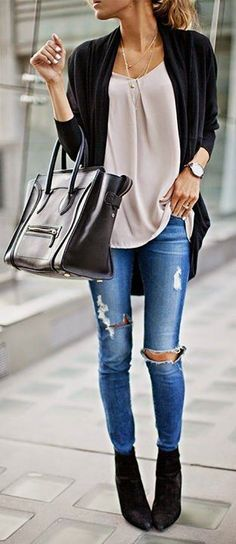 pony tail + oversized cardigan + light pink top + ripped skinny jeans + heeled booties