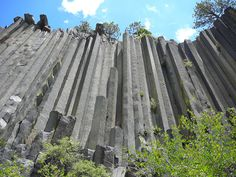 "Beautiful basalt columnar joints in California. These formed as magma cooled very slowly deep underground. The word ""basalt"" is said to mean ""very hard."""