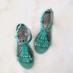 SALE HP jessica simpson / turquoise fringe shoes Super cute gladiator sandals by Jessica Simpson. Turquoise color with gold metallic studs and fringe detail. Some wear on sole, but other than that, excellent condition.  HOST PICK: GIRLY GIRL 2/20/16 Bundle Discounts available!⭐️ NO Trades Please ⭐️ Jessica Simpson Shoes Sandals