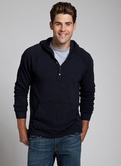 I have a sweater similar to this (black, gray down the sleeves, zip not button…
