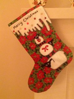 Christmas stocking. Appliquéd sheep. Quilted with free machine embroidery and embellished with sequins.