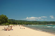 A busy summer day at West End Beach in Traverse City.