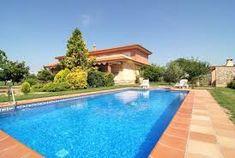 Villa de vacances avec piscine privée et vue fantastique dans un environnement tranquille.