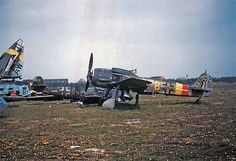 A Focke-Wulf Fw-190-A9 fighter that survived the war sits intact and parked amidst other wrecked aircraft at the Salzwedel Luftwaffe base west of the Elbe River (1945)...