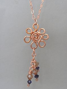 Flower Pendant Wirewrapped in Copper with Purple Crystals.