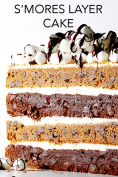 Looking for a crowd-pleasing cake? You've found it with this scrumptious S'Mores Layer Cake recipe, layers of chocolate, graham and toasted marshmallow frosting. #BiteMeMore #smores #cake