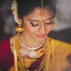"weddingsutra: ""Makeup so flawless... Find the dream makeup artist from your city on 'Makeup Gallery' http://ift.tt/1Tbgi6D  Bride- Saaksha Bhat Smile Makeover- @SmileEssentials Makeup Artist- @VimalGudka (Mumbai) Photo Courtesy- @reelsandframes (Mumbai)  #coralpout #southindianbride #lipstick #bride #indianbride #wedding #bridallook #weddingsaree #springbride #indianwedding #weddingsutra #bridallook #dday #bridalshoot #traditional #indianwedding #weddinglehenga #bridalmakeup #makeupartist…"