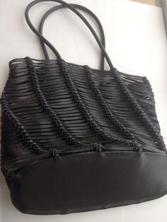 A personal favorite from my Etsy shop https://www.etsy.com/listing/230910488/vintage-leather-handbag-unique-design