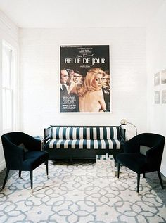There's something terribly sexy about a black-and-white striped couch. Flank it with two solid-color chairs, or flip the look and opt for two striped armchairs around a single-hue couch.