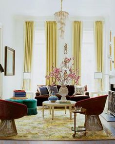 An Adler-designed cocktail table, vases, and sofa upholstered in a Designers Guild fabric in the parlor; the pillows are by Ankasa, the Warren Platner chairs are by Knoll, the curtains are made of a Manuel Canovas fabric, and the rug is a Lepore design for Doris Leslie Blau.