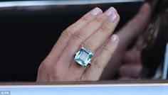 A close-up of the emerald-cut aquamarine ring which Meghan Markle wore this evening and once belonged to Princess Diana