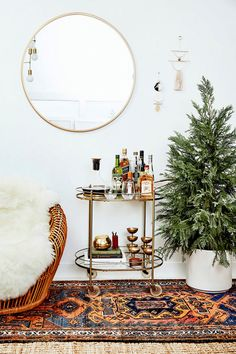 What better way to usher in the most wonderful time of the year than with a fun holiday party? Styling a bar cart with bottles of liquor, decanted wine, chic glassware, and gold accessories lets...
