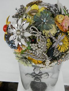 A mix of rhinestone, pearl, color, flowers, and bows. What a great way to display family jewelry Bling Bouquet, Wedding Brooch Bouquets, Bride Bouquets, Vintage Garden Parties, Buquet, Wedding With Kids, Fabric Beads, Flower Bracelet, Vintage Bridal