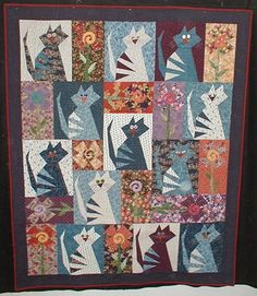 Stray Cat Blues art cat quilt.  Did this one, just need to put on the wiskers and back! Will I ever finish?