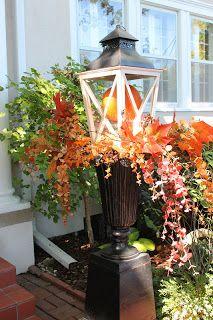 Tallgrass Design: Mary Carol Garrity Fall Home Tour -  Lantern on urn    Autumn floral display