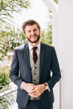 Vintage style navy groom suit with grey vest and burgundy knit tie | Raconteur Photography