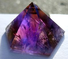 A perfect facet to the color zones ametrine by GoldenHourMinerals