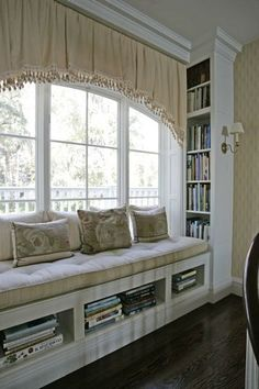 Love the window seat and book shelves