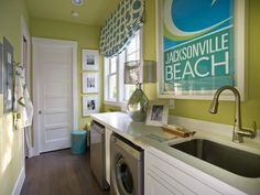 Both stylish and designed to make light work of large wash loads, the laundry room, the first space inside the home's secondary entrance, hints at color palette and Hollywood regency design style.