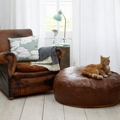 distressed leather lounge and ottoman