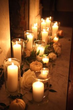 Candles, roses and white pumpkins