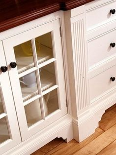Customize cabinets with furniture-style details. This traditional ex&le features pilaster moldings and blocky feet. & Adding