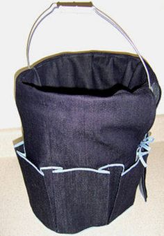 Cover a bucket to turn it into a sewing organizer and place for fabric/thread scraps