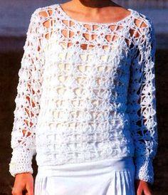 Un clásico fácil de hacer. Pullóver calado y blanco: dos características de un look etéreo y sensual a la vez.  El detalle son las perlas...