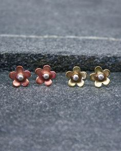 Cute and simple, these lovely mixed metal daisy earrings are a must for everybody's collection.  Available in copper, silver or brass.  Suitable for all occasions including weddings, birthdays or as a mothers day gift.  The daisies have been hand saw pierced from Copper and brass, then lightly domed and completed with sterling silver posts and butterflies.  Overall measurements are 8.5mm approx.  Listing is for one pair. Please specify at checkout which metal you would like.