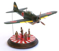 """Davide built Tamiya's scale Mitsubishi and finished it with Tamiya and Testors paints. """"It is a little plain,"""" he says of the kit. """"I prefer scale, but this is nice with the crew. Essentials Magazine, Model Kits, Tamiya, Small World, Scale Models, Fighter Jets, Modeling, Miniatures, Nice"""