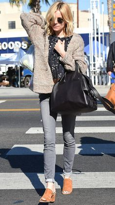 Sienna Miller in gray jeans, a star-print top and a cardigan - click ahead for more celebrity winter outfit ideas