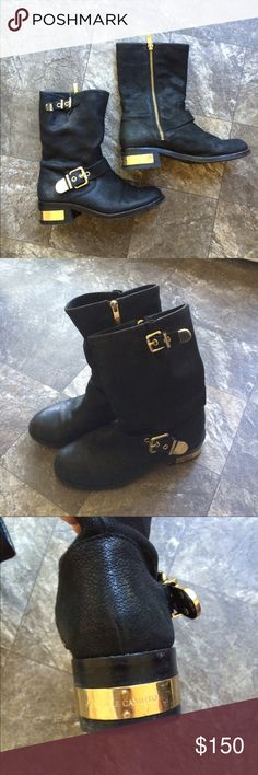 Vince Camuto Winchell boots Great condition Vince Camuto Winchell boots, size 7, black leather with gold buckles, zippers and heel plate. Some wear on the heel. Vince Camuto Shoes Combat & Moto Boots