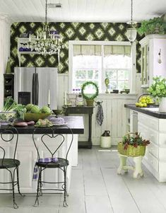 white kitchen cabinets and green wallpaper