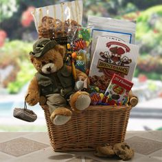 Fish Tales  Fishing Gift    Packed away in this handy willow basket they'll find Frederick, the fishing teddy bear along with gummi fish kabobs, onion dill pretzels, crunchy trail mix chocolate chip cookies, and jelly beans. Happy Fishing!