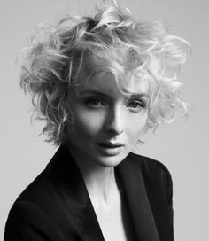 A medium blonde curly wavy coloured messy short hair styles wacky hairstyle by Angels Hairdressing