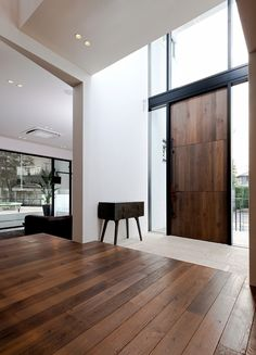 ENTRY. Step up from front door. Leave shoes on lower step. This style is too modern, but has the right quality of light and spaciousness. >>>