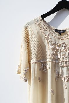 I'm into sheer/gauzy Ivory blouses for Spring/Summer paired with old broken in jeans/jean shorts...or whatever suits my fancy that day...