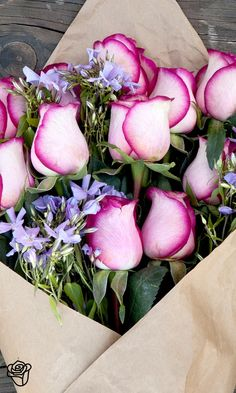 Don't be desperate, send 'Desperado'! This arrangement of pink roses and purple phlox sends a beautiful and romantic message without going over the top.==