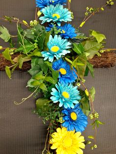 (DETAIL) My Spring 2014 Season Grape Vine Cross with Faux Florals: Sky, Light Blue and Yellow Gerber Daisies, Wild Grass blooms on Ivy... Design and Arrangement by http://nfmdesign.synthasite.com/