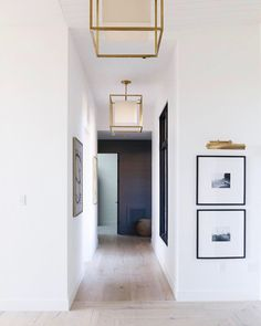 A selection of modern hallway ideas for high-end interior design projects Entryway Lighting, Interior Lighting, Entryway Decor, Lighting Ideas, Picture Lighting, Entryway Chandelier, Modern Hallway, Entry Hallway, Hallway Sconces