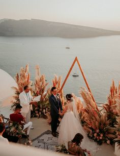 Santorini Wedding with Pink Pampas Grass Plumes + Magical Moments - Green Wedding Shoes Grecian Wedding, Greek Wedding, Elegant Wedding, Our Wedding, Wedding Venues, Beach Ceremony, Wedding Ceremony, Wedding Venue Inspiration, Santorini Wedding