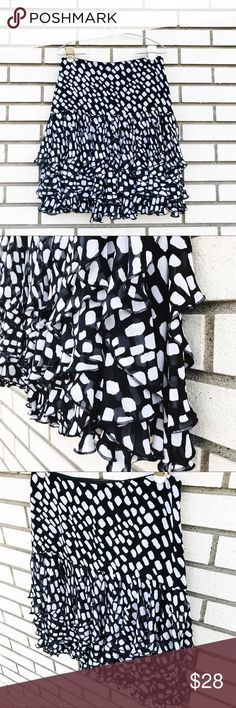 White House Black Market Ruffled Skirt White House Black Market Ruffled Skirt Such a fun skirt! Tiered fluttery ruffles. Black and white print. Size 2. Fully lined. 21 inches long. Concealed side zipper with hook and eye closure. **Excellent used condition, however there is one small snag on he front left hip. Not really noticeable when worn. Please see last photo.** White House Black Market Skirts