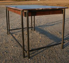 the Pilcher desk...steel frame topped with black walnut built by Metal Fred Designs Inc.
