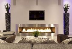 Living Room - Modern stainless steel fireplace surround, clean lines with just the essentials.